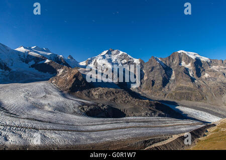 Night view of the Bernina massive and Morteratsch glacier at the mountain house of Diavolezza, in Engadine area - Stock Photo