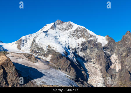 Close view of the Piz Bernina from Diavolezza on a sunny day. It is the  the highest mountain in the Eastern Alps - Stock Photo