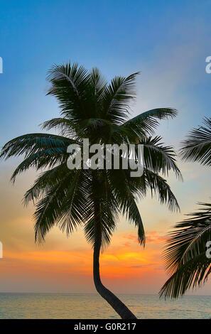 Sunset over ocean on Maldives - Stock Photo