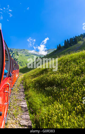 Beautiful view of the alps on the steam train towards the Brienzer Rothorn, on Bernese Oberland, Switzerland. - Stock Photo