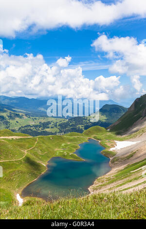 Aerial view of the Eisee (lake) near Brienzer Rothorn on Bernese Oberland, in Jungfrau region of Switzerland. Vertical - Stock Photo