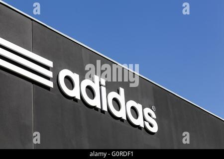 Adidas logo on a wall - Stock Photo