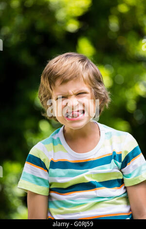 A little boy is making a funny face - Stock Photo