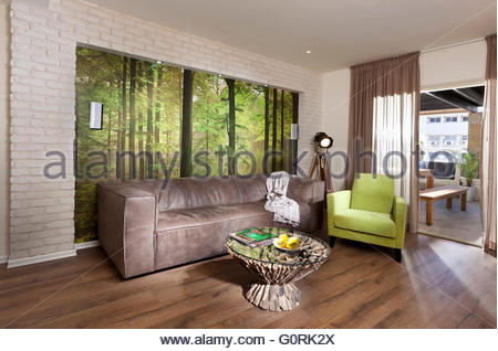 Grey furniture in open plan living room and kitchen of for G plan living room furniture