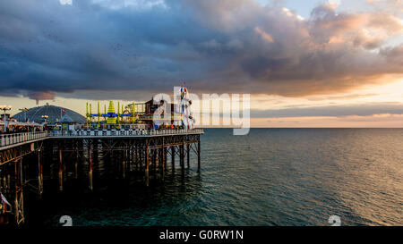 Evening on Brighton pier, East Sussex, England - Stock Photo