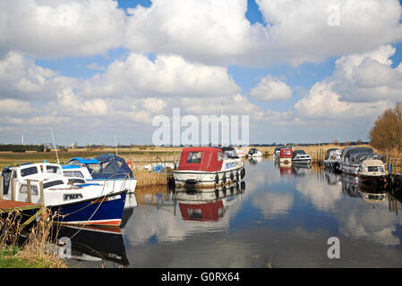 A view of boats moored at Hardley Staithe on the Norfolk Broads by the River Yare at Hardley, Norfolk, England, - Stock Photo
