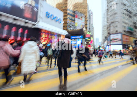 Hong Kong SAR, China - Jan 27 2016: blured images of the crowded streets at the Hennessy Road, Causeway Bay. - Stock Photo