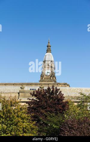 Bolton town hall clock tower behind the civic centre,  viewed from the west. - Stock Photo