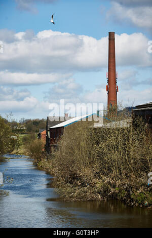 Rams bottom public art  coat of arms   Ramsbottom River Orwell factory on banks chimney industry light industrial - Stock Photo