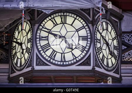 London paddington railway station clock large 3 faces roman numeral scaffolding restoration clock face hands time - Stock Photo