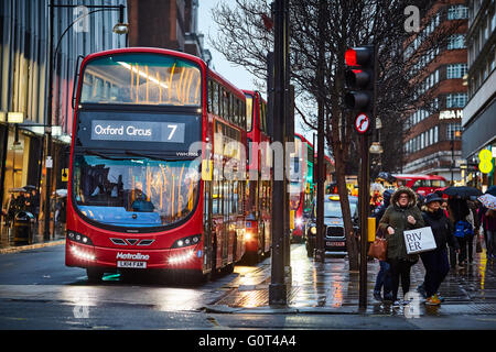Oxford Street Transport transporter transportation transported traveling getting about by on going  commuter commuting - Stock Photo