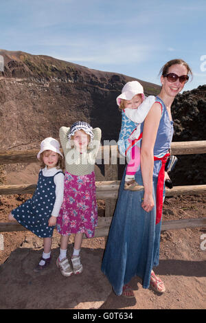 Tourist woman children family at the crater of Mt. Mount Vesuvio / walk to the top summit of Mount Vesuvius near - Stock Photo