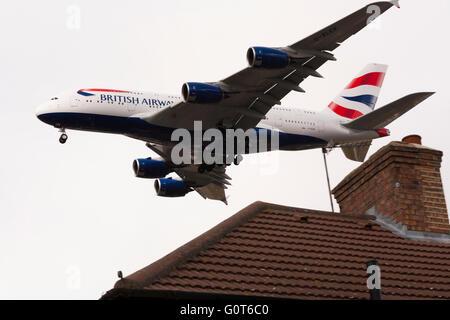 British Airways Airbus A380 - 841 (G-XLEK) landing over roof tops at London Heathrow airport.