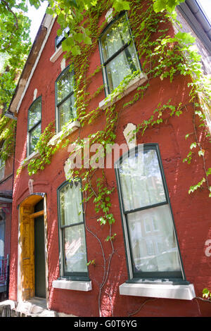 A quaint red brick residence in the trendy Wicker Park neighborhood in the West Town community in Chicago, Illinois, - Stock Photo