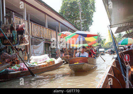 Goods displayed in a floating market near Bangkok Thailand - Stock Photo