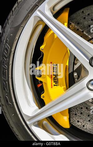 Yellow Brembo carbon ceramic brake calipers on a Ferrari. - Stock Photo