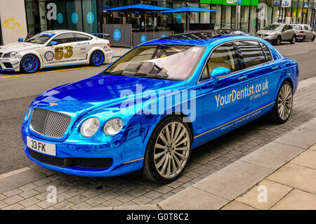 A Bentley Flying Spur with blue mirrored paint, concierge vehicle for YourDentist.co.uk of Harley Street - Stock Photo