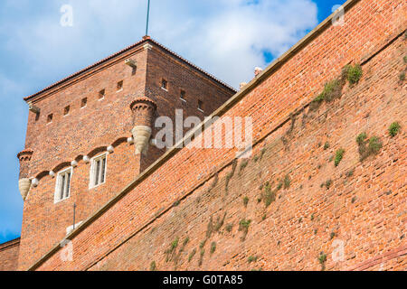 Krakow wawel castle wall, a pair of middle aged tourists peer over the immense defensive wall of the Wawel Royal - Stock Photo