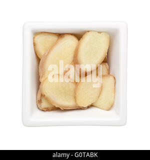 Sliced ginger in a square bowl isolated on white background - Stock Photo