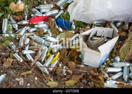 Nitrous oxide canisters used as a legal high , known as hippy crack,laughing gas,sweet air. - Stock Photo