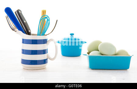 Set of kitchen utensils on a white rustic wooden background - Stock Photo