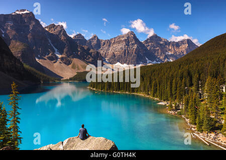 A man enjoying the view of Moraine Lake by sunrise, Banff National Park, Alberta, Canada, America (Canadian Rocky - Stock Photo