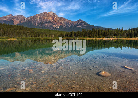 Patricia Lake by sunrise, with Pyramid Mountain in the background, Jasper National Park, Alberta, Canada, America. - Stock Photo