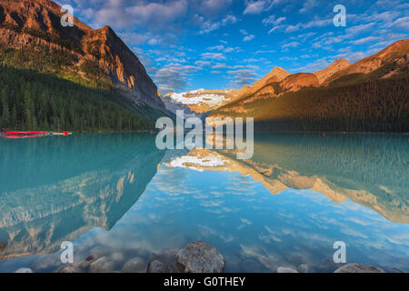 The wonderful Lake Louise, one of the most beautiful spots in the Rockies, by sunrise. Banff National Park, Alberta, - Stock Photo