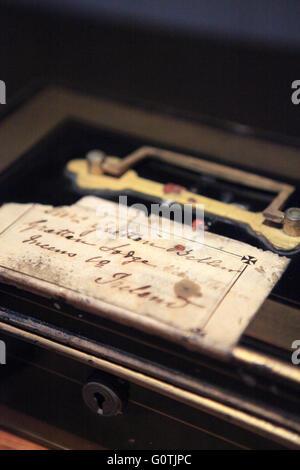 Black & gold vintage money box, cash box - Stock Photo