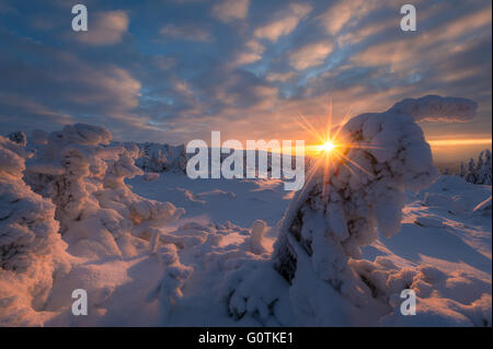 Sunset over snow covered landscape, Norway - Stock Photo
