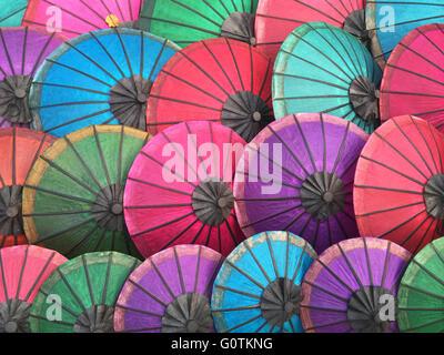 Multi-colored parasols in market, Luang Prabang, Laos - Stock Photo