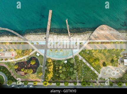 Aerial view of Molos Promenade on the coast of Limassol city in Cyprus. A view of the walk path surrounded by palm - Stock Photo