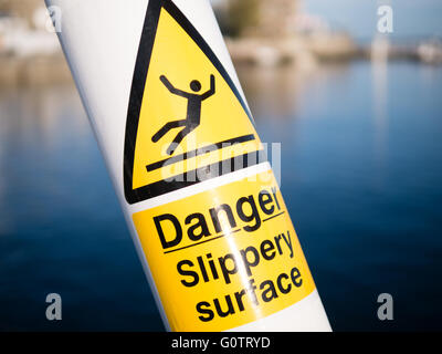 Danger Slippery Surface Sign, Cowes, Isle of Wight, England - Stock Photo