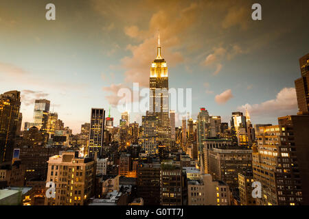 NEW YORK - AUGUST 23: View to Midtown Manhattan with the famous Empire State Building at sunset. - Stock Photo