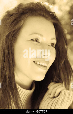 Toned Sepia Portrait of a Woman Smiling and Happy - Stock Photo