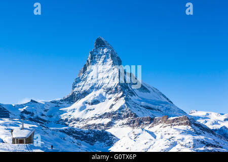 View of Matterhorn and the Riffelberg Chapel chapel, Zermatt, Switzerland - Stock Photo