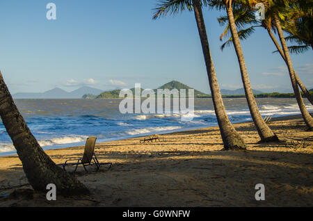 Palm Cove, one of the tropical northern beaches of the Cairns region. - Stock Photo