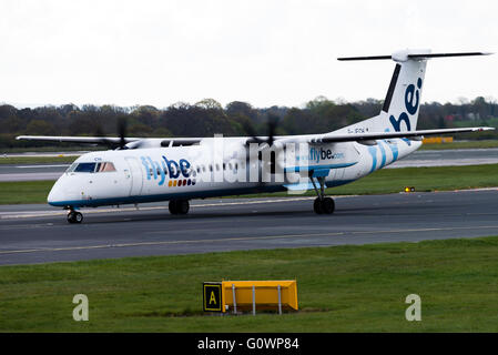 Flybe Airline Bombardier Dash 8-402Q Airliner G-JECH Taxiing at Manchester International Airport England United - Stock Photo