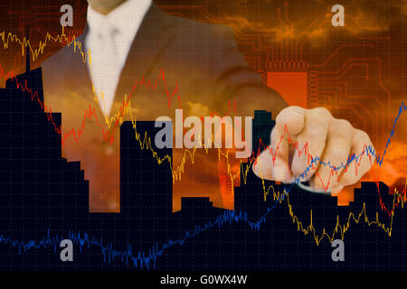 Composite image of smiling businessman in suit pointing - Stock Photo