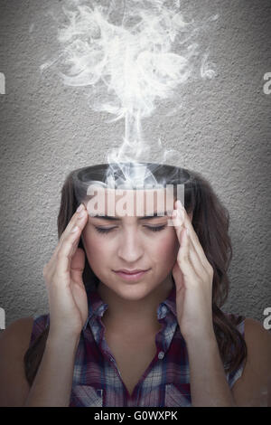 Composite image of upset woman suffering from headache - Stock Photo