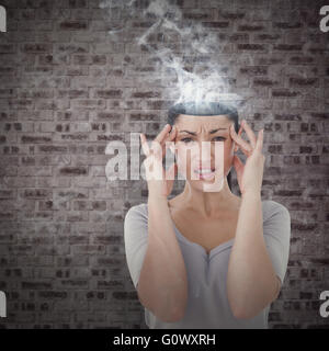 Composite image of brunette suffering from migraine - Stock Photo