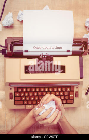 Once upon a time against above view of old typewriter - Stock Photo
