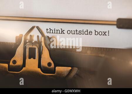 Think outside box! against close-up of typewriter - Stock Photo