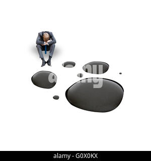 A businessman unhappy with oil prices - Stock Photo