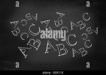 ABC written on a blackboard - Stock Photo