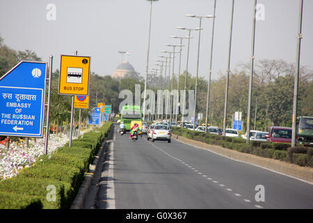 Shanti Path, New Delhi, with beautiful hedges on both sides, well maintained flower beds and lawns, embassies on - Stock Photo