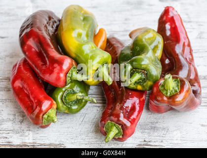 Red green and yellow sweet peppers - Stock Photo