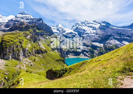 View of the Bluemlisalphorn above Oeschinen lake in Kandersteg on Bernese Oberland in Switzerland - Stock Photo