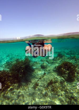 Women snorkeling in the Blue Lagoon,Cyprus in the Mediterranean Sea on a boat tour - Stock Photo