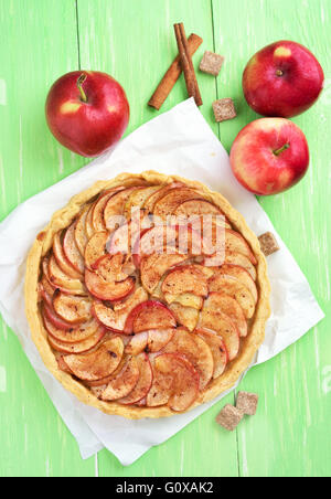 Apple pie on green wooden table, top view - Stock Photo